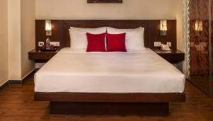A bed or beds in a room at Red Fox Hotel, Alwar