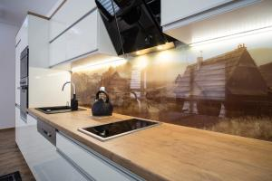 Kuchnia lub aneks kuchenny w obiekcie Willa Pod Grapą