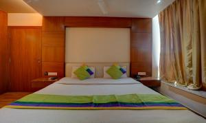 A bed or beds in a room at Treebo Trend B&B Hotel