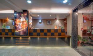 The lobby or reception area at Treebo Trend B&B Hotel