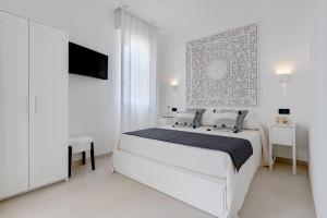 A bed or beds in a room at B&B Rocamatura - Adults only