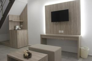 A television and/or entertainment center at Vallian Village Hotel
