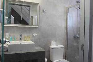 A bathroom at Vallian Village Hotel