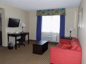 A television and/or entertainment center at Best Western Plus Portage Hotel and Suites
