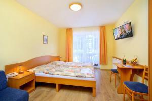 Кровать или кровати в номере Pension Alba