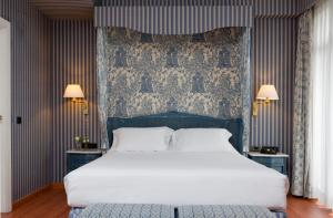 A bed or beds in a room at Agumar