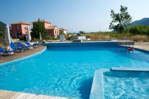 The swimming pool at or near Calypso Luxury Studios