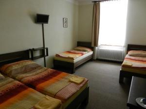 Кровать или кровати в номере Hotel Beránek
