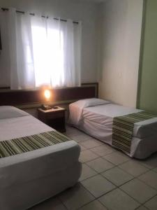 Cama ou camas em um quarto em Princetel Palace Hotel