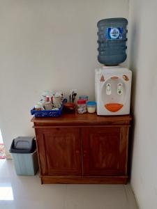 A kitchen or kitchenette at Rosalina Homestay