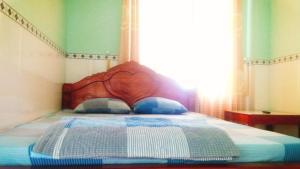 A bed or beds in a room at Mỹ Châu Huyện Đảo Lý Sơn