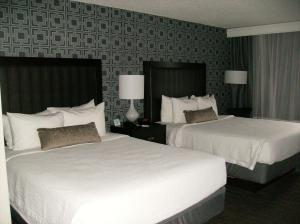A bed or beds in a room at Best Western Plus Bradford Inn