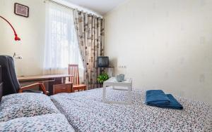 A bed or beds in a room at 24 Khamovnicheskiy Val Ulitsa