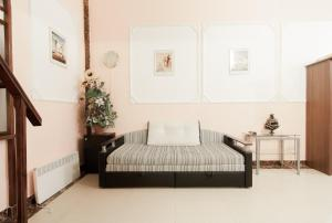 A bed or beds in a room at Rent Apartments Grecheskaya 50