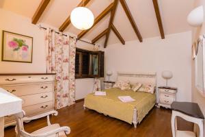 Un ou plusieurs lits dans un hébergement de l'établissement Astra Villas
