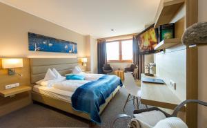 Кровать или кровати в номере Hotel Moserhof
