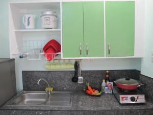 A kitchen or kitchenette at Cool Stay Inn