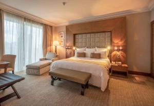 A bed or beds in a room at Gulf Hotel Bahrain