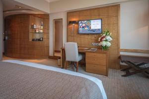 A television and/or entertainment center at Gulf Hotel Bahrain