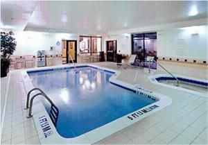 The swimming pool at or near SpringHill Suites Savannah Airport