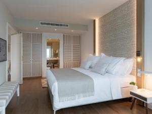 Łóżko lub łóżka w pokoju w obiekcie Hotel Bellevue Dubrovnik