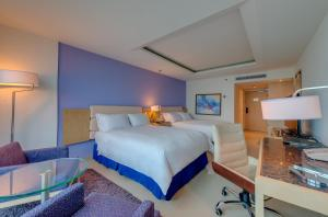 A bed or beds in a room at Hilton Cartagena