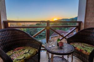 A balcony or terrace at Pousada Suiça Mineira Centro
