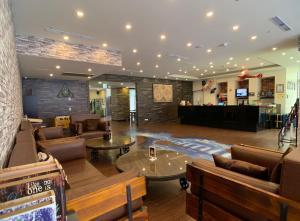 The lobby or reception area at Skyone Hotel