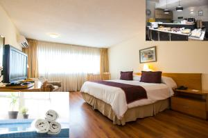 A bed or beds in a room at Armon Suites Hotel