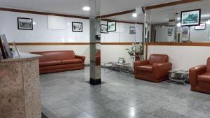 O saguão ou recepção de Hotel Único