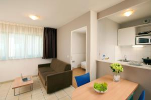 Гостиная зона в Séjours & Affaires Serris Rive Gauche