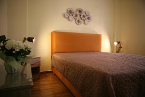 A bed or beds in a room at Marika Apartment