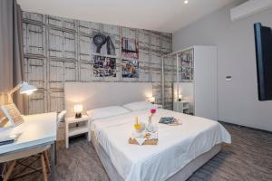 Cama o camas de una habitación en Downtown Boutique Hostel