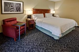 A bed or beds in a room at Hampton Inn Charlotte/Matthews
