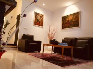 The lobby or reception area at Hotel Portinari