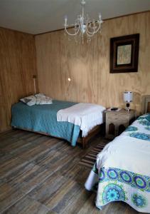 Cama o camas de una habitación en Alojamiento El Aromo
