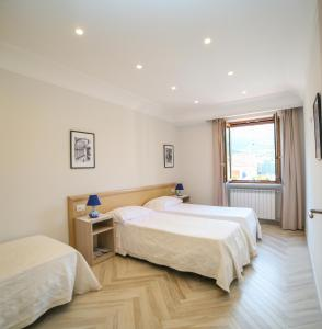 A bed or beds in a room at Casa Vacanze Vittoria