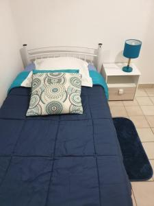 A bed or beds in a room at Appartement Mango - Baie-Mahault