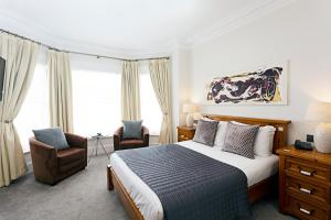 A bed or beds in a room at Andover House Hotel