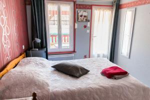 Un ou plusieurs lits dans un hébergement de l'établissement Le Rocher