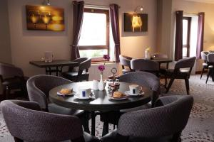 A restaurant or other place to eat at The Priory Hotel