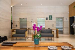 O saguão ou recepção de Hilton Garden Inn Belo Horizonte Lourdes
