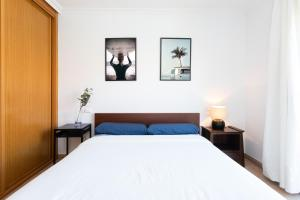 A bed or beds in a room at Playa Tejita III NomaHolidays by Bossh! Apartments