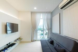 A television and/or entertainment centre at Straits Garden Suites, Georgetown