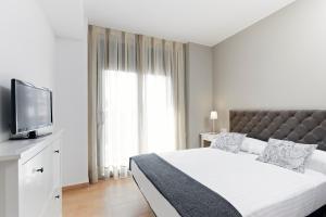 Letto o letti in una camera di Barcelona Apartment Gran de Gràcia