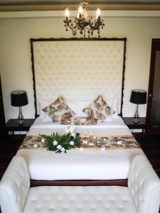 A bed or beds in a room at Lio Villas Resort