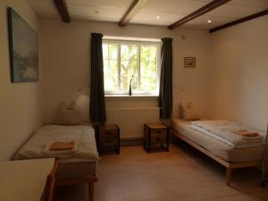 A bed or beds in a room at Birkely Bed and Breakfast