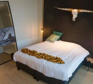 A bed or beds in a room at Hotel Shamrock