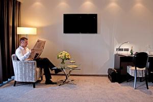 Телевизор и/или развлекательный центр в Hotel Favor