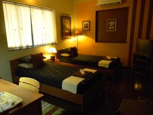 A bed or beds in a room at Bodhi Tree